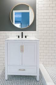 how to hang a bathroom mirror above your vanity