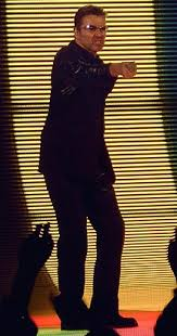 michael george ladies gentlemen the best of george michael dvd. Unique Michael George Michael Discography Dressed In A Black Leather Suit  Standing On Stage Holding Out For Ladies Gentlemen The Best Of Dvd 0