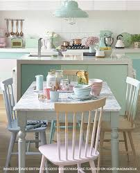 a gorgeous pastel dining room and kitchen area with painted chairs 600x742 our southern home