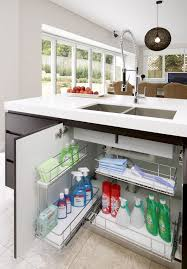 under kitchen sink cabinet. Under Kitchen Sink Cabinets Pullout Iron Drawer Cleaning Tools Ceramic Tile Floors Divided Stainless Steel Cabinet