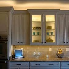 led lighting above cabinet and inside glass cabinet undercabinet above cabinet lighting