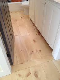 i like how they did the transition into bathroom with board laid opposite flooring direction in