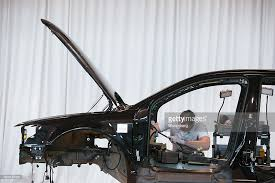volkswagen ag phaeton automobile manufacture photos and images an employee works in the wiring harness cable assembly inside a volkswagen phaeton automobile on the