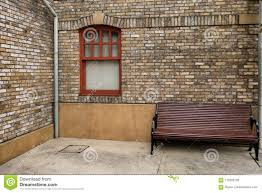 old brick furniture. Glass Window On Old Brick Wall And Big Wooden Chair Stock Photo - Image Of Background, Reflection: 110292702 Furniture