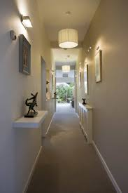 image hallway lighting. Hallway Illuminated With Drum Shade Pendants And Wall Sconces : Lighting Fixtures That Add Visual Image