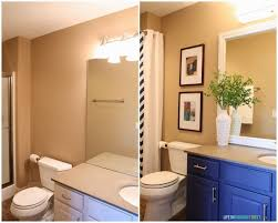 update bathroom mirror: guest bathroom lighting and framing a builder grade mirror