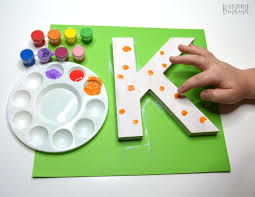 cute painted letter craft adding fingerprint polka dots