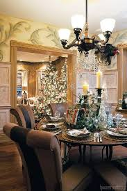 by hanging glistening snowflakes from the chandelier and incorporating a mixture of pillar candles greenery and translucent trees this round dining
