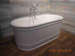 freestanding bathtubs for small spaces. white oval freestanding tubs inspiration on wooden floors and natural wall tile in fancy small space bathtubs for spaces