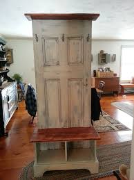 door hall tree made from an antique door and a custom bench and shelf to fit the finish is an old worn look i love this piece and it is very functional