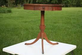 antiquevintagecarvedwoodmersman7072roundlamp tablewith antiquevintagecarvedwoodmersman7072roundlamp tablewith drawerlions head pulllions feet three legs