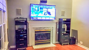 after samsung plasma tv wall mounted above fireplace boston acoustic in wall speakers mounted to the left and right of the tv boston acoustic bravo 20