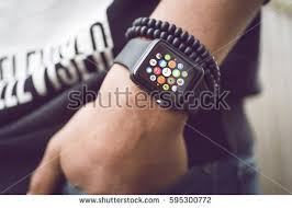 apple watch men. hilversum, netherlands - march 03, 2017: young man wearing apple watch. multiple watch men