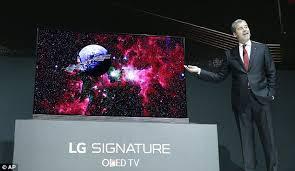 lg 98 inch tv price. david vanderwaal, vice-president of marketing for lg electronics usa, displays the new lg 98 inch tv price