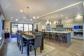 Sleek Modern Kitchen Design With A Large Kitchen Peninsula And
