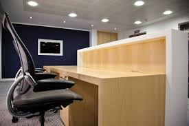 reception desk in light wood reception unit design