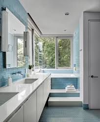 blue bathroom tiles. Bathroom Featuring Blue Tiles Wall And Flooring Along With A Double Sink Corner Tub.BFDO Architects
