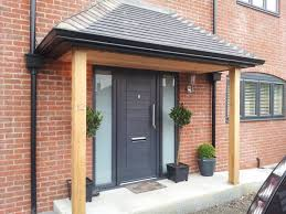 black front door with glass side panels