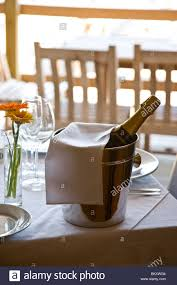 Ice Bucket Table Unopened Champagne Bottle In An Ice Bucket On A Restaurant Table