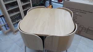 ikea fusion round table with 4 unusual shaped chairs which fit snugly round and under table