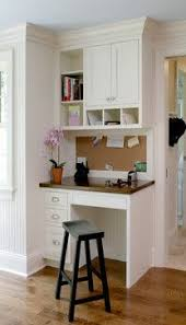 Miscellaneous Spaces - traditional - Home Office - CWP Cabinetry. a small  desk area in the kitchen