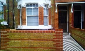 Small Picture London brick wall and Victorian black and white mosaic tile path