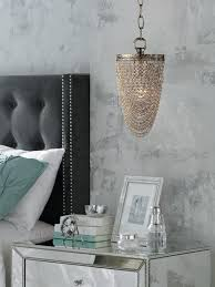 contemporary gray bedroom with mirrored nightstand