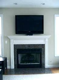 tv on top of fireplace mounted above fireplace ideas on top of fireplace mounting flat screen