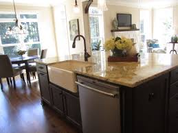 build kitchen island sink: charming glass and ceramic vase on kitchen island with sink placed near with curved metal faucet