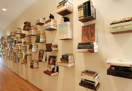 whole wall covered with small bookshelves looks interesting ...