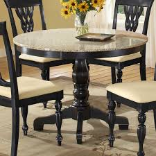 round black wooden granite topped dining table