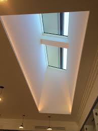 skylight lighting. skylight and light well with led strips hidden along the two long edges looks like soft comes from our at night time lighting pinterest