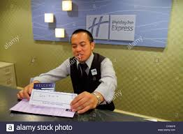 rhode island newport middletown holiday inn express motel hotel front desk lobby asian man employee clerk
