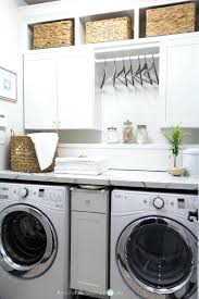 diy laundry cabinets beautiful laundry room makeover love the space for hangers between the upper cabinets diy laundry cabinets