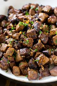 bites of sirloin steak in a garlic sauce
