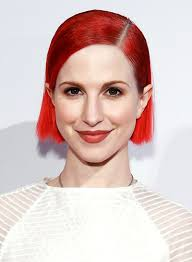 hayley williams with a short red straight edgy hairstyle