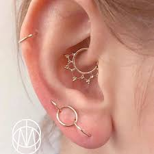 check out this daith piecing by salabodymod using the solid gold anoora ring buddhajewelryorganics jewelry solidgold daith curatedear