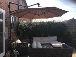 cantilever operated wall mounted parasol