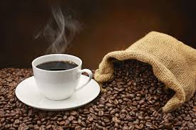 coffee beans cup. Wonderful Beans M Steamingcupofcoffeeonpileofcoffeebeans000019447735_Large In Coffee Beans Cup A