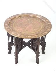 atlas coffee table brass tray or cattelan