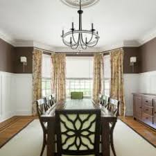 Transitional Brown Dining Room With Bay Window