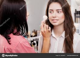 backse scene professional make up artist doing makeup for yo stock image