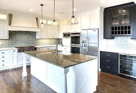 white kitchen with gray granite countertops and subway tiles inside decor 21