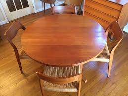 danish modern circular teak dining table with 2 leaves