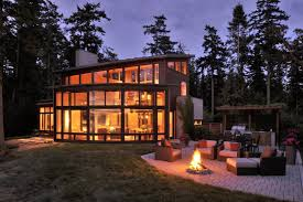 fantastic modern house lighting. View In Gallery Wood House With Curved Glass Walls Overlooking Sunset Bay 2 Thumb 630x418 10961 Fantastic Bayfront Modern Lighting E