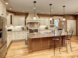 three decorative pendant lights add interest to this elegant kitchen the white globes suspended from