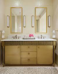 gold bathroom vanity with gray ikat rug