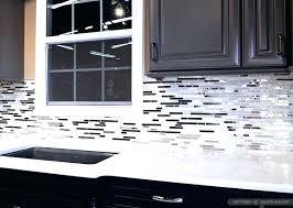 black white backsplash and gray kitchen tile cabinets