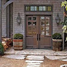 barn style front doorFarmhouse Front Doors  Farmhouse front Front stoop and Strap hinges