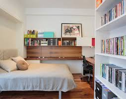 noho duplex small trendy bedroom photo in new york with white walls and medium tone hardwood bedroom home office view